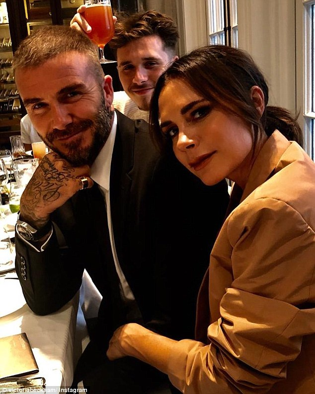 Down Under delights: The Beckhams are certainly making the most of their visit to Australia for the 2018 Sydney Invictus Games. Pictured (left to right): David, Brooklyn and Victoria