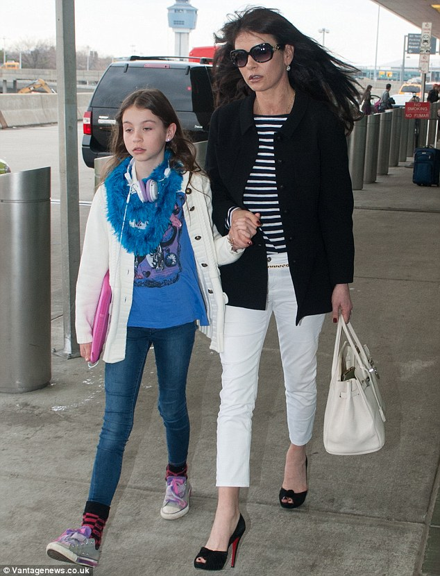 On Saturday: Just two days earlier his wife Zeta-Jones and their daughter were seen leaving JFK airport, as Douglas (not pictured) trailed behind