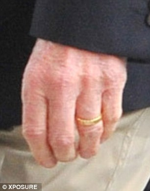 Band together: The 69-year-old was sporting his wedding ring